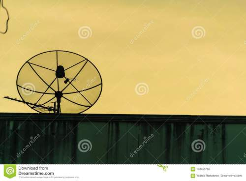 small resolution of satellite dish silhouette communication antena radio for tv on building brick with gold sky background