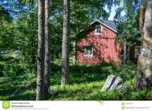 Scandinavian Red Wooden House In Forest Stock