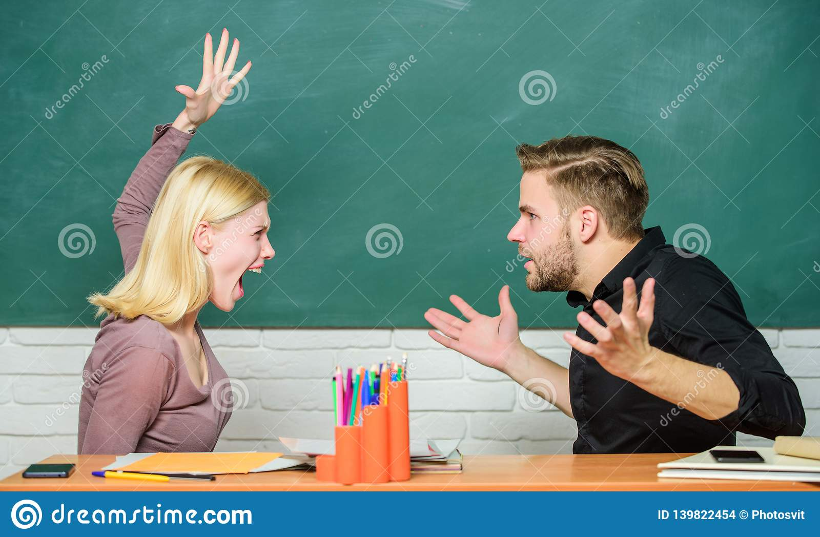 School Conflict Angry Woman Going To Man With Her Fists