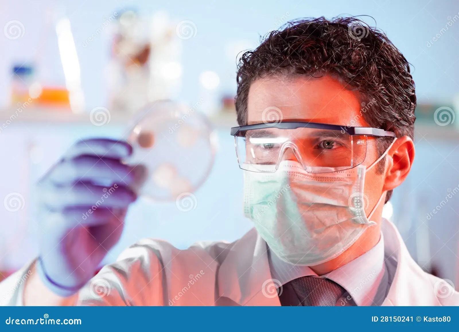 Scientist Observing Petri Dish Stock Image
