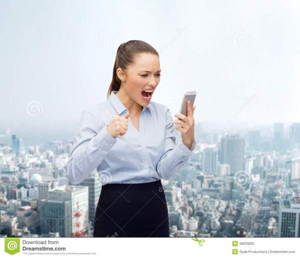 Screaming Businesswoman With Smartphone Stock