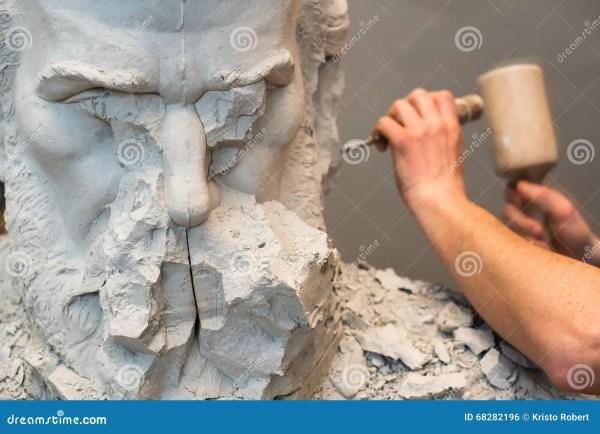 Person Carving Sculpture