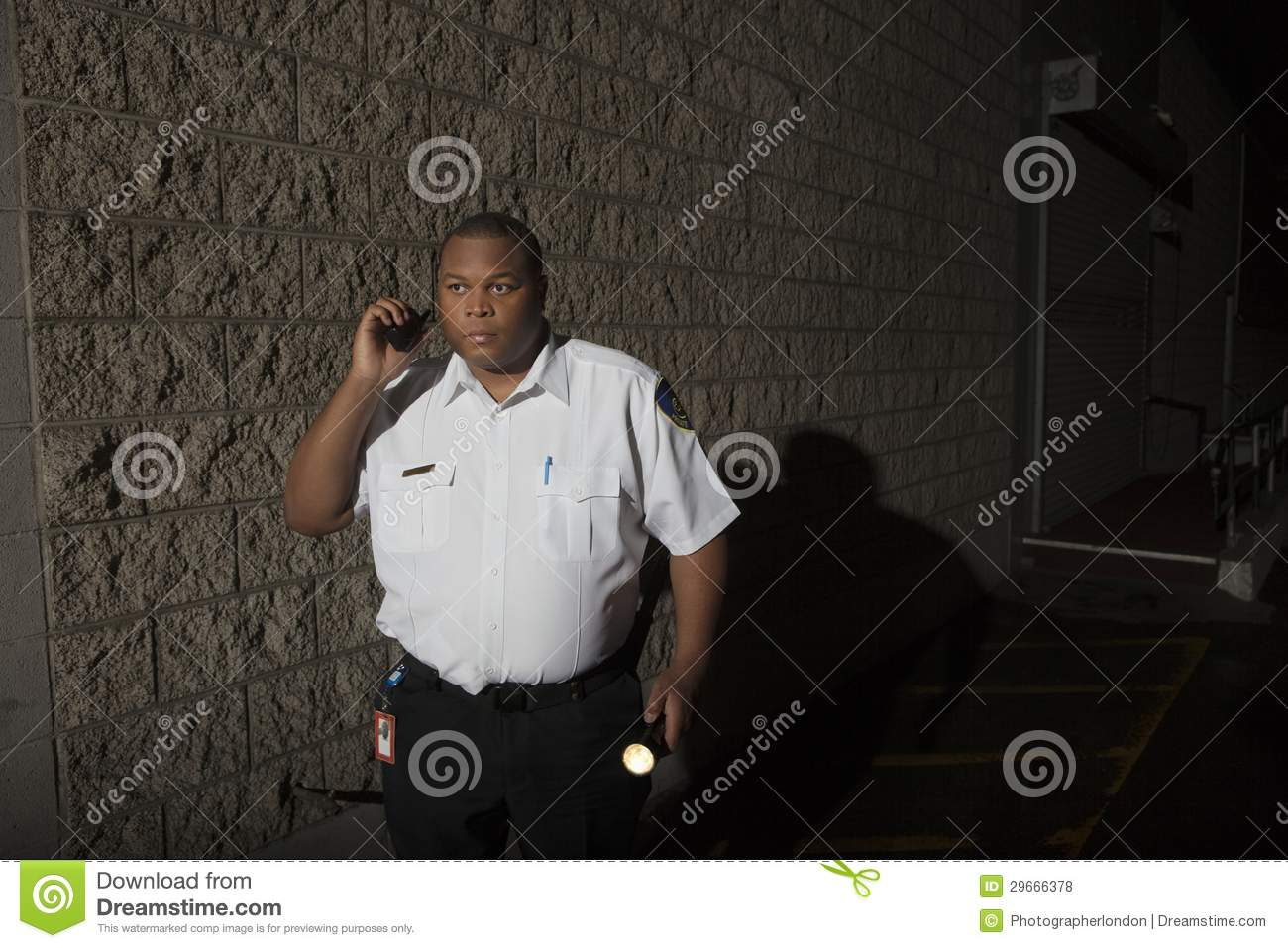 Security Guard With Walkie Talkie And Torch Patrols At Night Royalty Free Stock Photos  Image