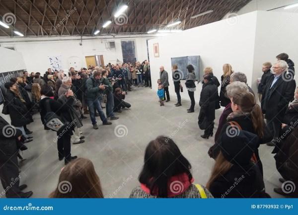 Senior Artist Giving Speech Crowd Art Museum Exhibition Opening Editorial