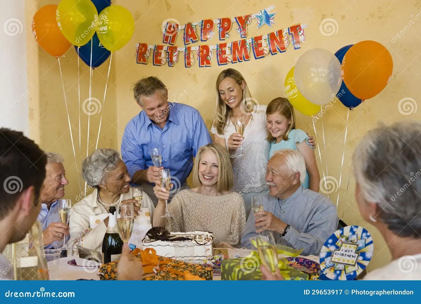 Senior Couple Celebrating Retirement Party Royalty Free