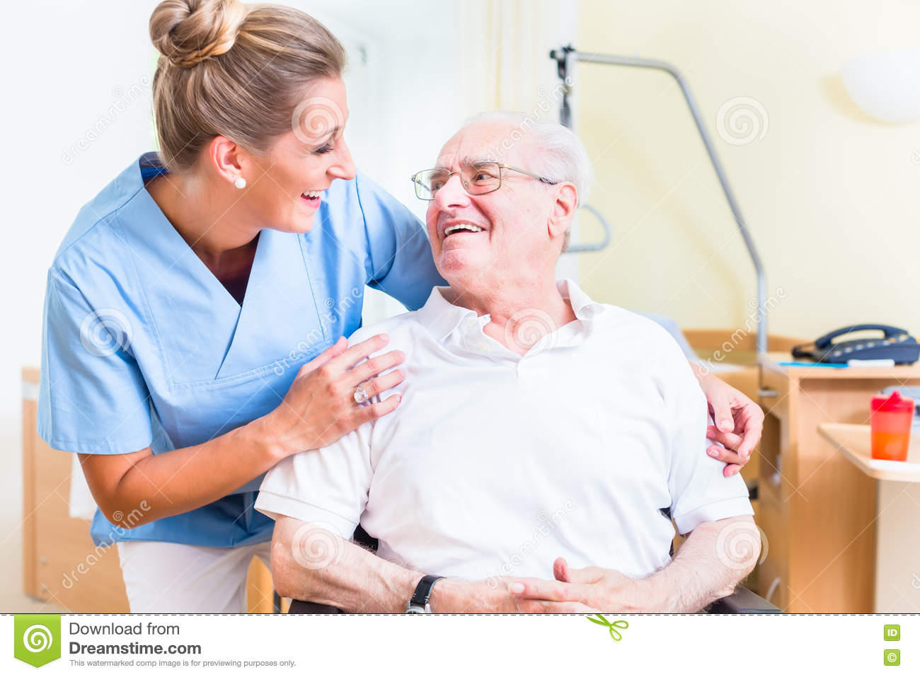 geriatric chair for elderly ricon wheel lift senior man and old age nurse in nursing home stock photo - image: 71287113