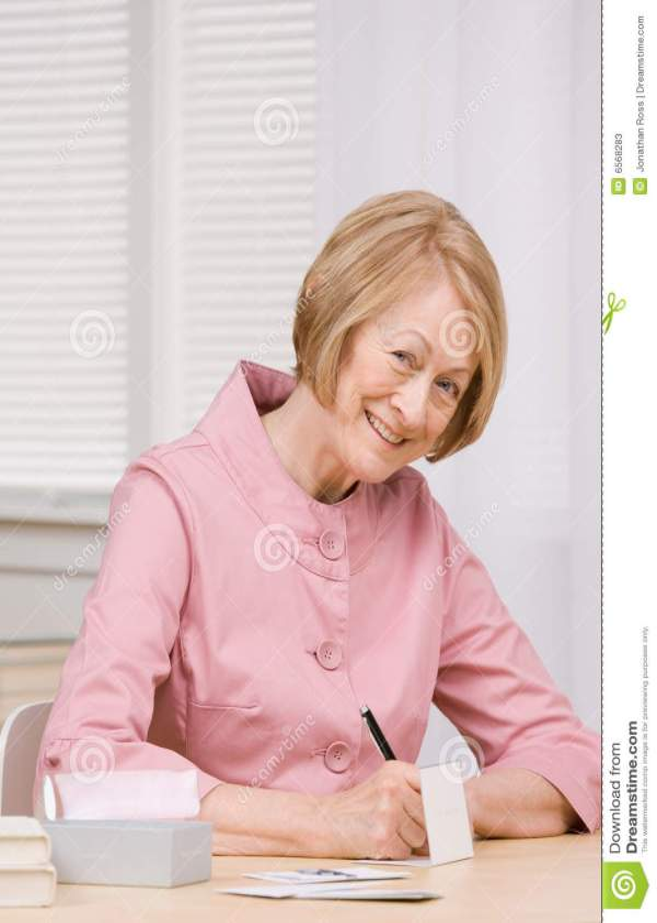 Senior Woman Paying Bills At Desk Stock Image - Image of ...
