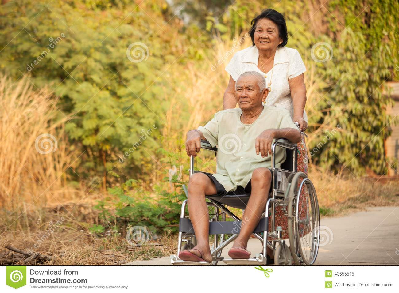 Husband Chair Senior Woman Pushing Her Disabled Husband On Wheelchair