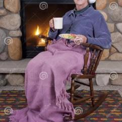 Free Rocking Chair Plans Outdoor Folding Chairs Argos Senior Woman Fireplace Christmas Stock Photo - Image: 17615984