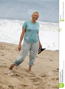 Senior Woman Standing Barefoot Beach Portrait Royalty
