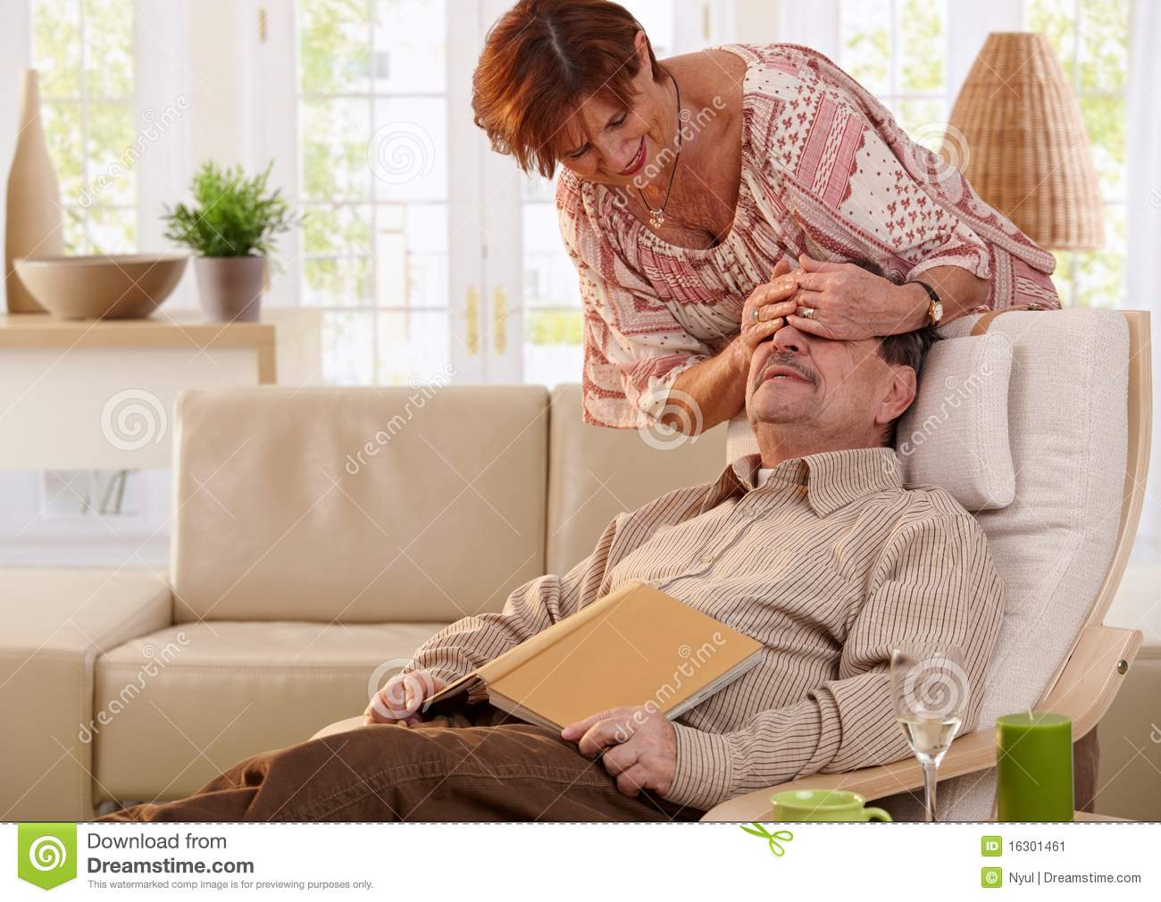 Husband Chair Senior Couple Sitting On Living Room Chair Reading Stock