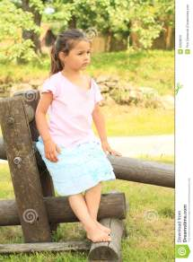 Seriouse Girl Sitting Wooden Construction Stock
