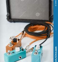 electric guitar stomp effectors and cables in studio focus is on forehand switch box  [ 1153 x 1600 Pixel ]
