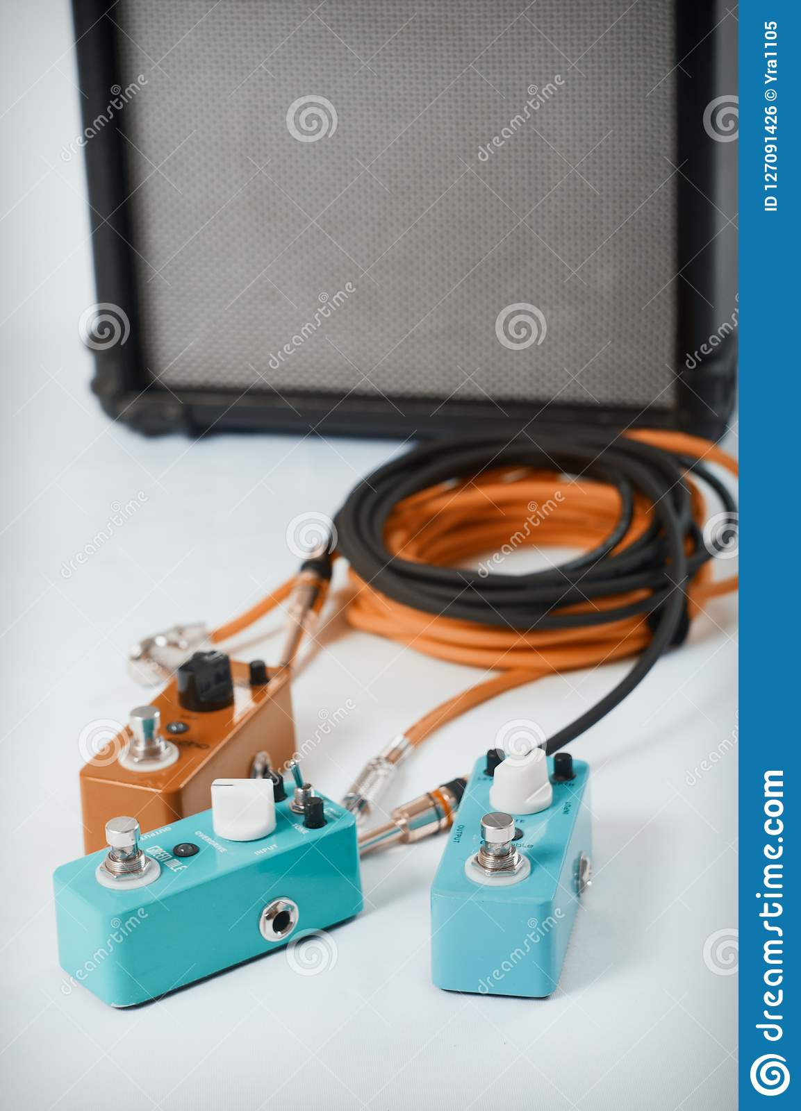 hight resolution of electric guitar stomp effectors and cables in studio focus is on forehand switch box