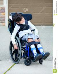 Seven Year Old Biracial Disabled Boy In Wheelchair Stock ...