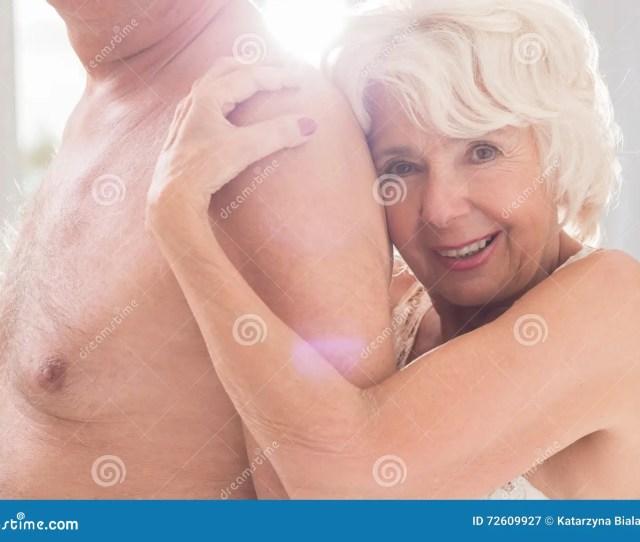 Hot Mature Women Embracing Her Sexual Partner Smiling