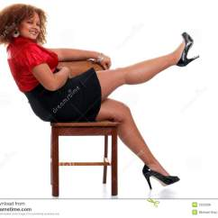 American Girl High Chair Table And 4 Chairs African Woman On A Lifting Her Leg Stock Photo