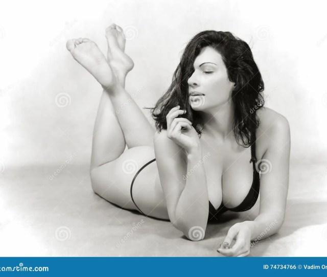 Brunette In Lingerie Lying On The Floor
