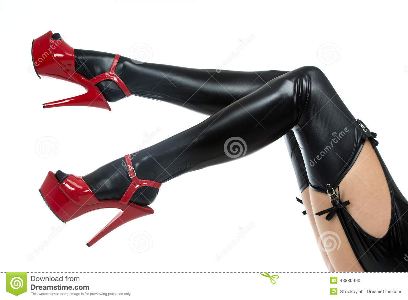 Legs In Latex Stockings And High Heels Shoes Stock Photo