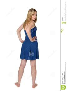Woman In Short Blue Dress And Bare Feet Stock