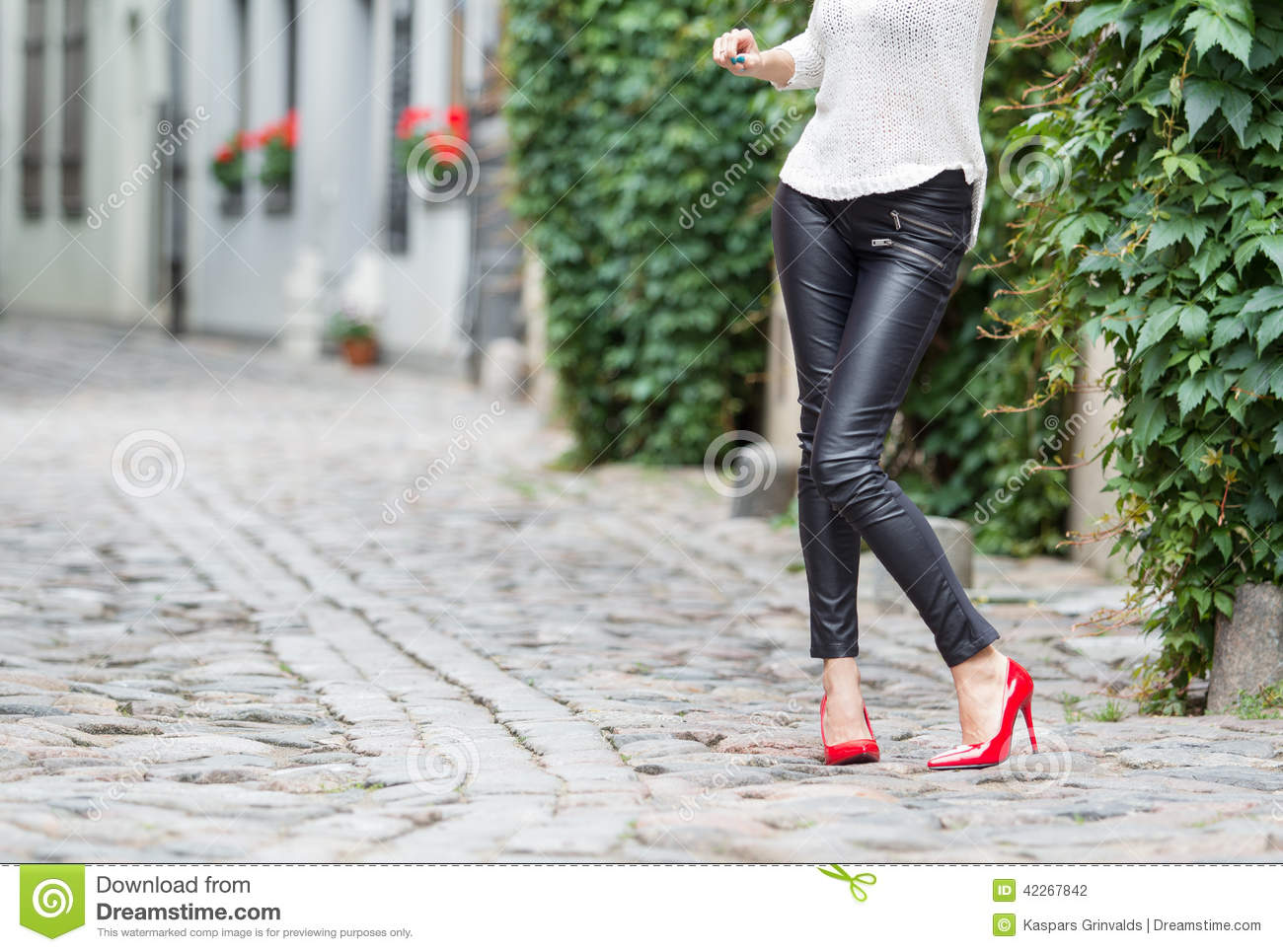 Sexy Woman Wearing Red High Heel Shoes In City Stock Photo