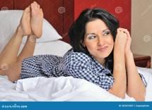 Young Hispanic Woman Bed In Men' Shirt Stock