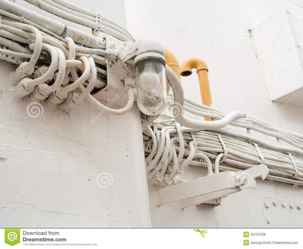 medium resolution of lone outdoor light and many heavy duty outdoor electrical wires on