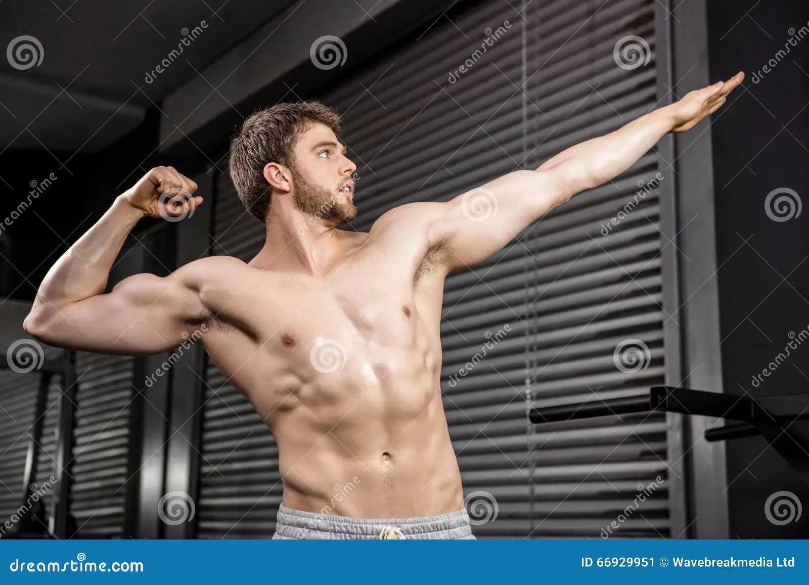 shirtless man flexing muscles