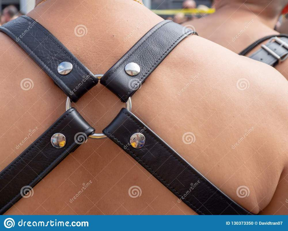 medium resolution of shirtless white man wearing a quad strap leather harness