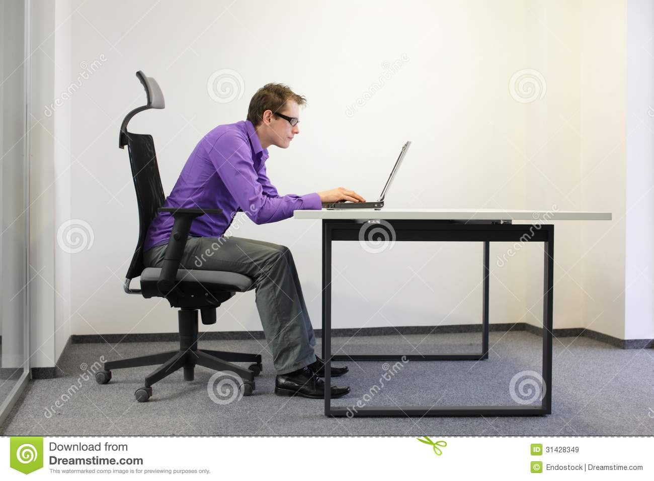 bad posture in chair best living room chairs shortsighted businessman sitting at laptop