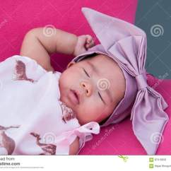 Baby Girl Chair Plastic Outdoor Chairs A Shot Of Cute With Purple Headband While Sleeping And Playing On The Pink Focus At Infant