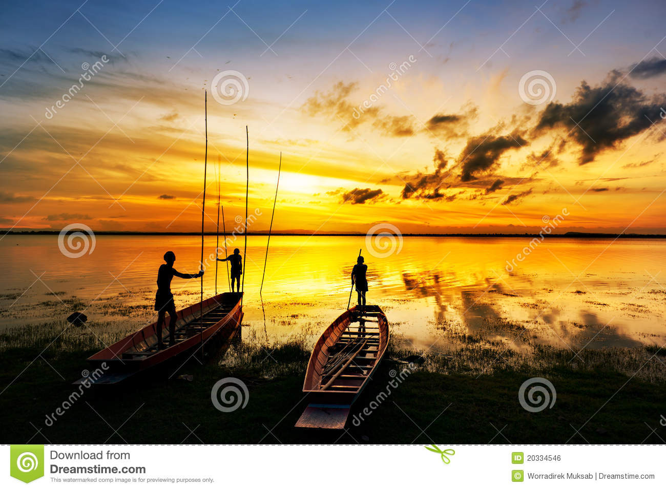Silhouette Of Children On Boat Stock Photo