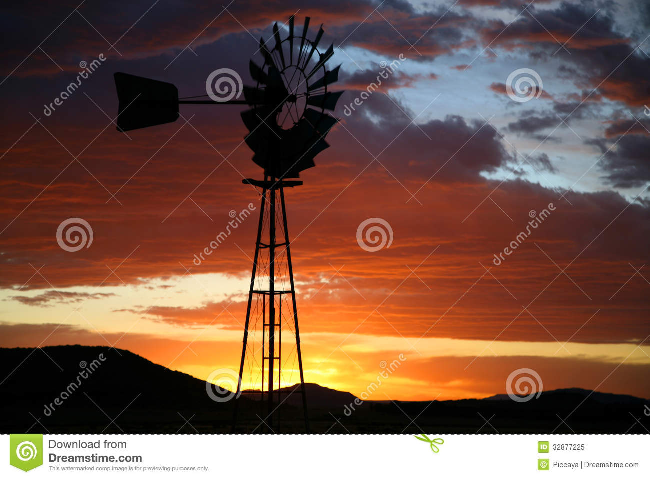spinning top chair south africa covers by hana silhouette of farm windmill at sunset royalty free stock