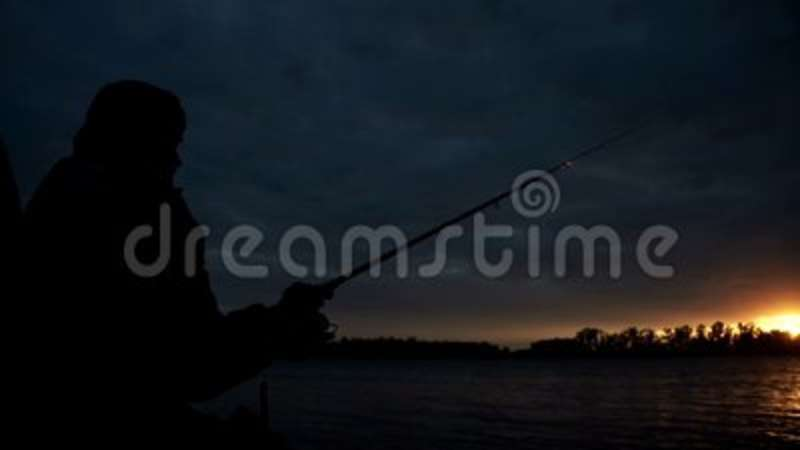 fishing chair crane wicker outdoor chairs adelaide silhouette fisherman sitting on and throwing rod in river stock video of pond leisure 102849813