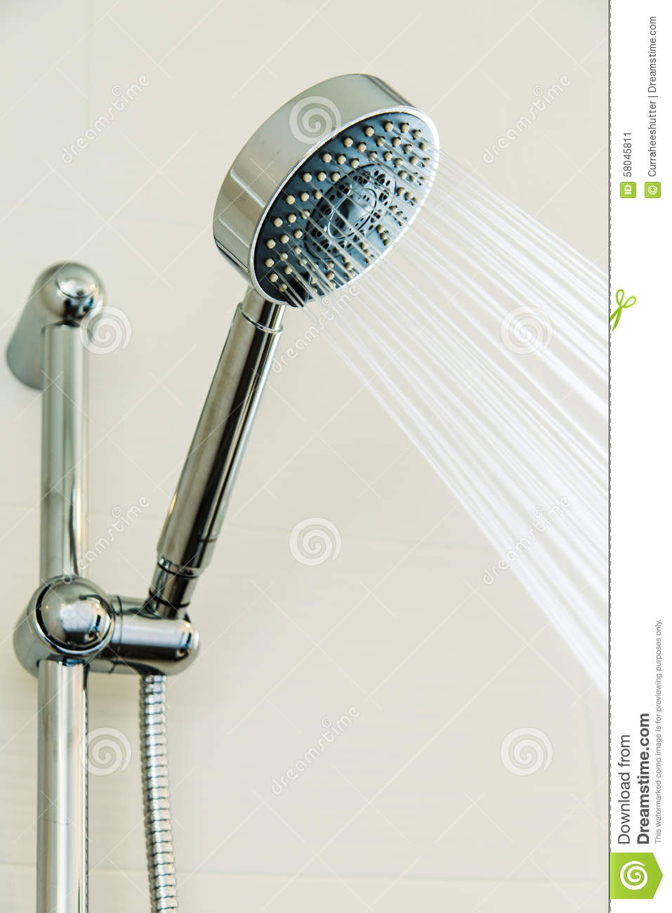 Silver Shower Head In Bathroom With Water Drops Flowing