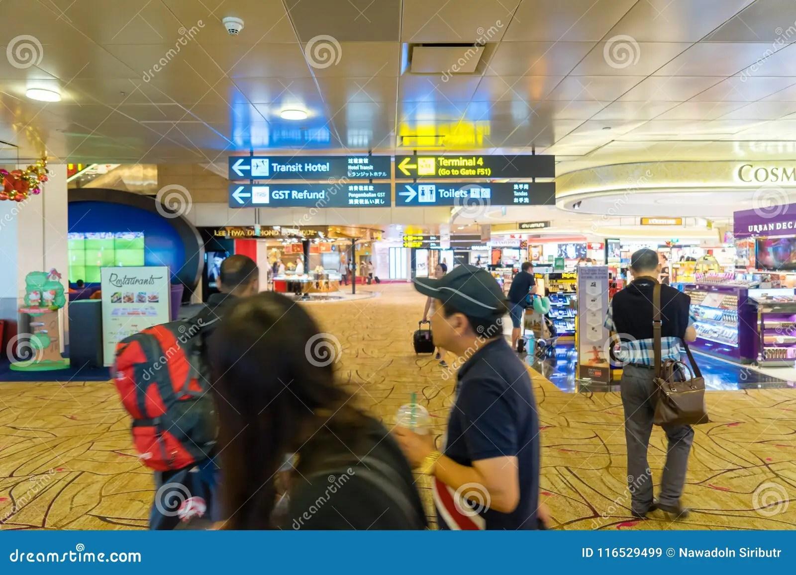 Visitors Walk Around Departure Hall In Changi Airport