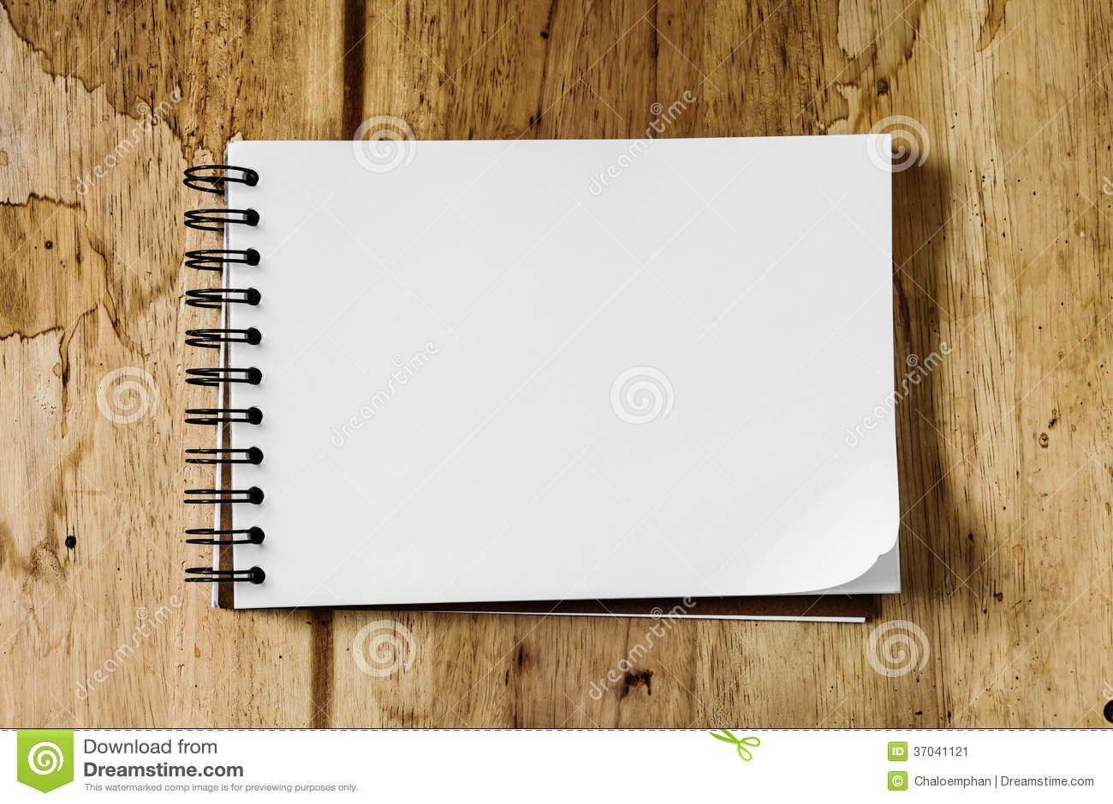 Sketchbook Against Wood Background Stock Image  Image