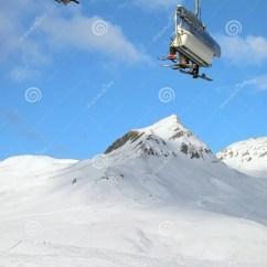 Ski Chair Lift Target Purple With Skiers Switzerland Stock Image