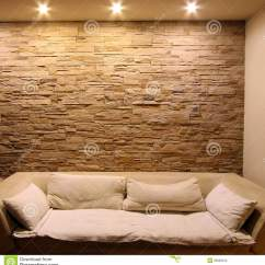 Sofa Bed Prices Three Seat Slate Stone Wall With Couch Stock Photos - Image: 26699243