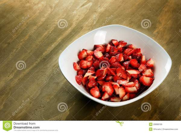 Sliced Strawberries In A Bowl Royalty Free Stock Images