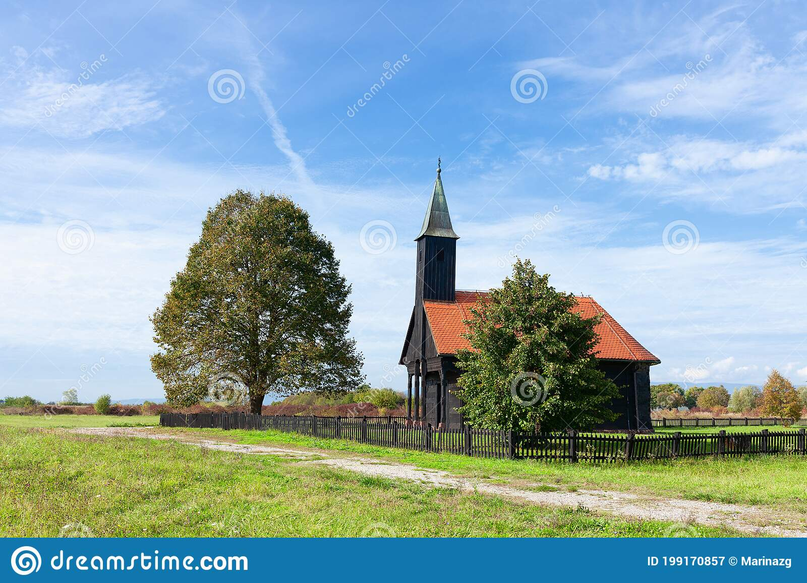 small black wooden church in the countryside with black picket fence red tile roof stock image image of scene field 199170857