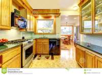 Cozy Kitchen Room With Tile Counter Top, Kitchen Island ...
