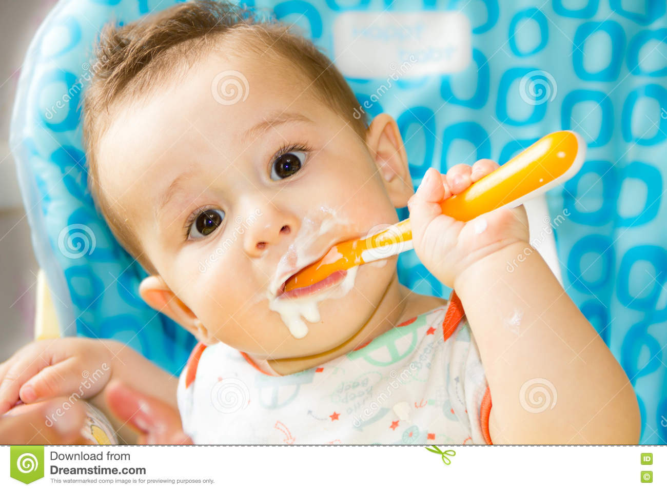 Baby Food Chair Small Happy Child Sitting In A Chair And Eats Yogurt From