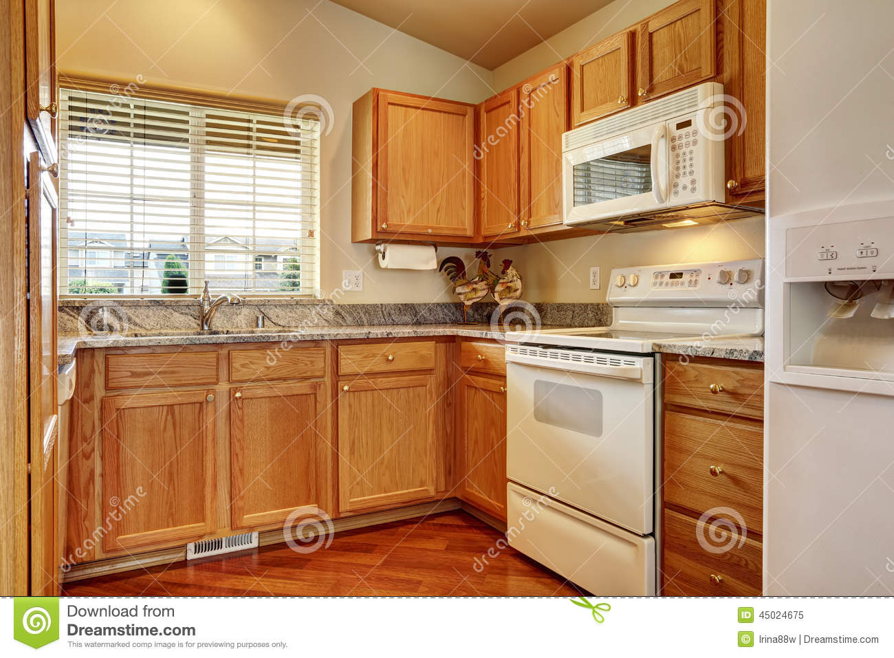 refrigerator for small kitchen cabinets orlando area with white appliances stock image