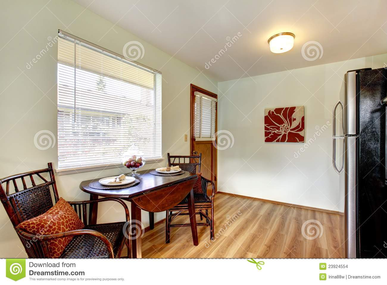 small eat in kitchen table gray island eating area interior stock photo