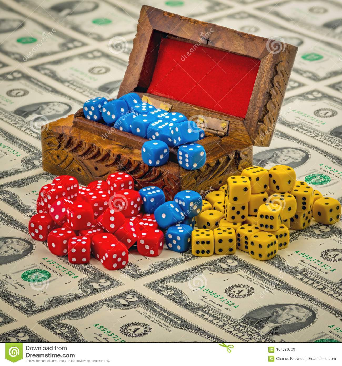 Old Wooden Box Filled With Game Dice On A Sheet Of Money