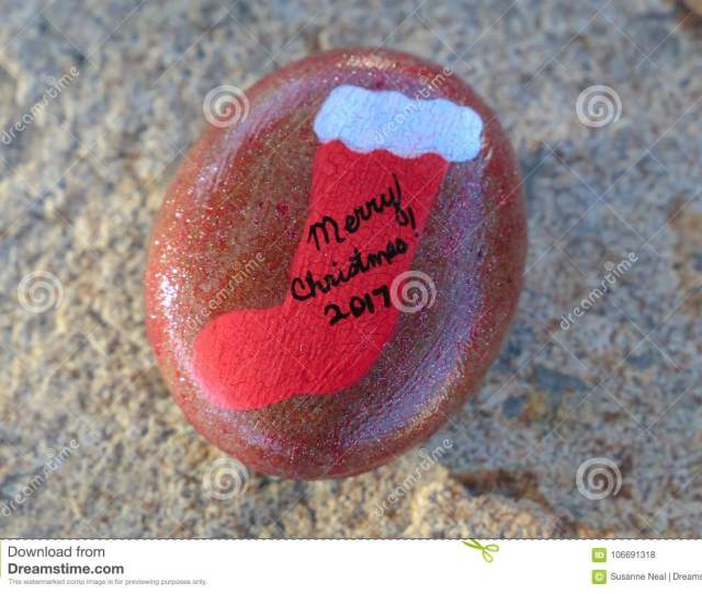 Small Rock Painted Red With Christmas Stocking And Merry Christmas
