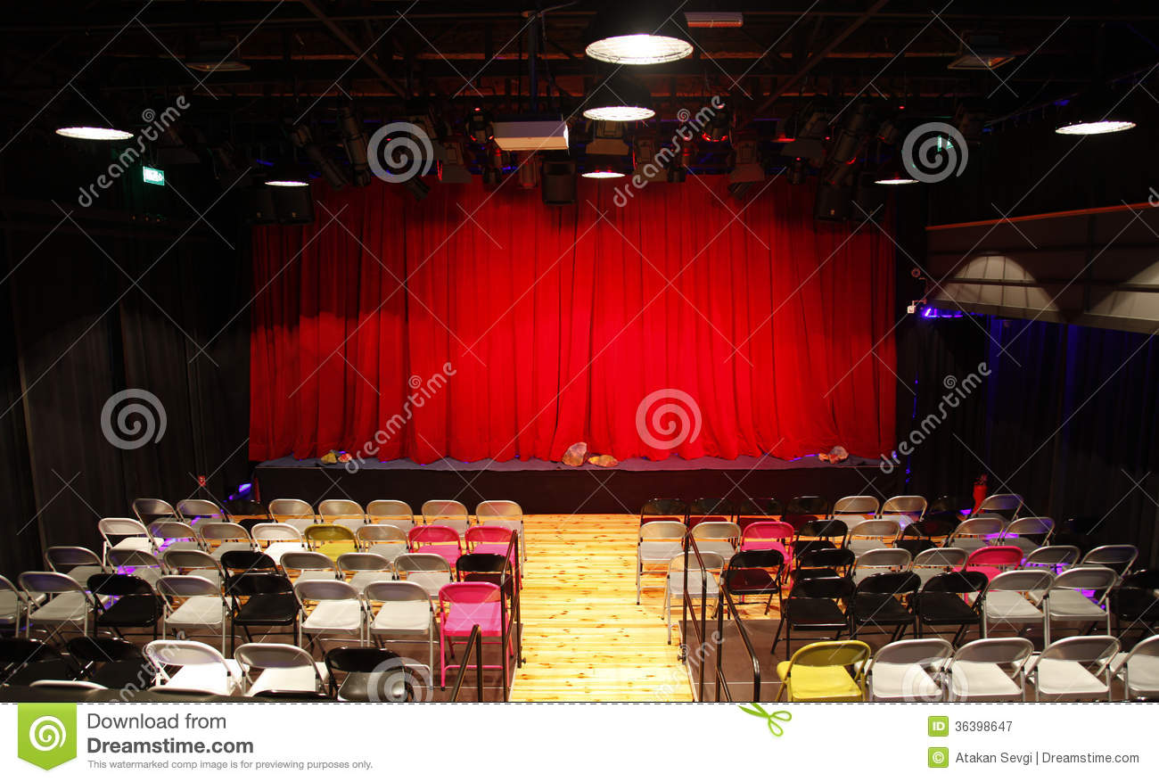 Small Theatre Hall With Red Curtains Stage And Chairs