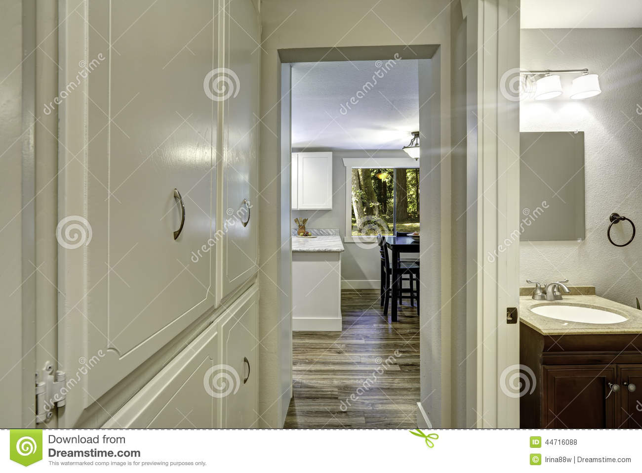 Small Walkthrough With Builtin Cabinets And Exit To