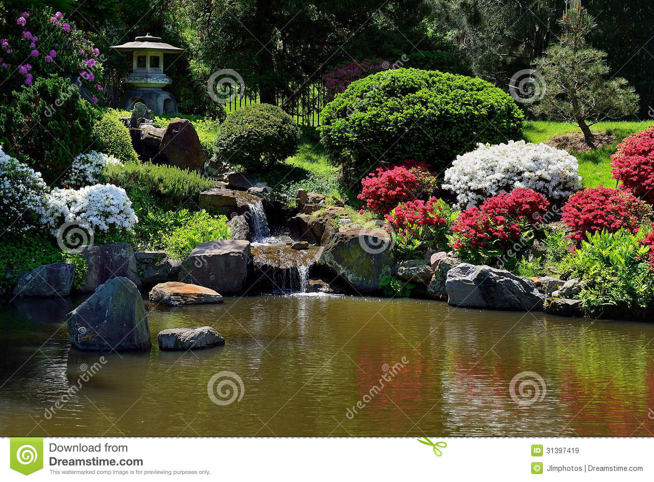 Small Water Fall Fountain In Asian Japanese Garden Stock